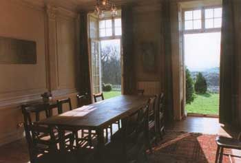 Dinning room with french windows out to the lawn