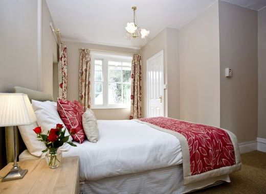Ensuite bedroom with garden views and private balcony