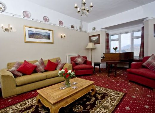 One of Two comfortable lounges with seaviews, open fire, piano, TV and CD
