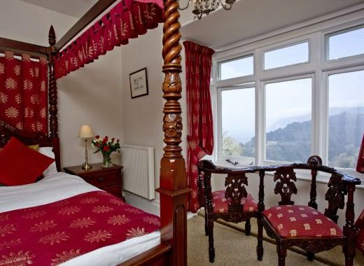 Four poster ensuite, with spectacular views of Exmoor and the sea